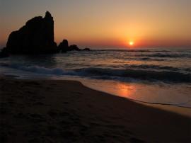 Papel de parede Pôr-do-sol na Praia: Pedras