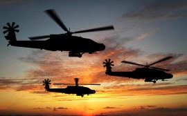 Papel de parede Helicópteros Apache no Por do Sol